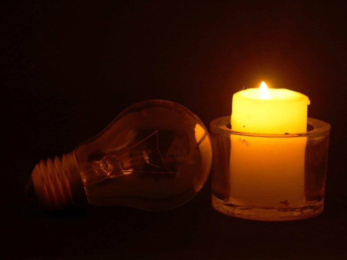 Lightbulb and candle